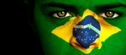 Woman with Brazilian flag painted on her face